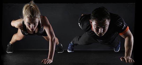 Man and Woman Exercising Image